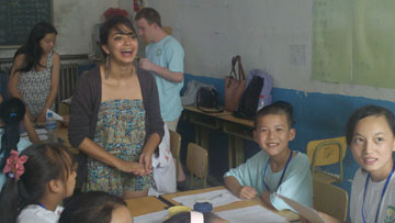 Natalia Perea (UCLA 2013) volunteer teaching an English class in China, part of a UCLA International Institute travel study program in Beijing in summer 2012. (Photo: Cindy Fan, Vice Provost of International Studies, Interim.)