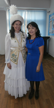Performing Kazakh songs in traditional clothes. The beautiful headdress is known as a saukele.