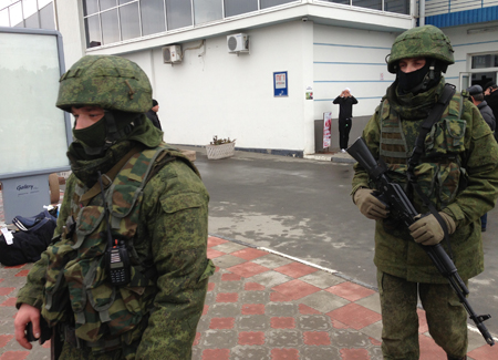 "February 28, 2014. Armed men without insignia (so-called ""little green men,"" i.e., Russian troops) in Simferopol Airport, Crimea. Photo: <a href=""https://commons.wikimedia.org/wiki/File:VOA-Crimea-Simferopol-airport.jpg"">Elizabeth Arrott, VOA via Wikimedia</a>, 2014."