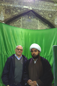 Al-Kifl, Iraq. Hirsch with an Islamic cleric at the shared Muslim/ Jewish shrine of Prophet Dhu al-Kifl/ Prophet Ezekiel.