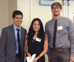 From left: Erik Pena, Academic Counselor Sandy Valdivieso and James David Hillmer at the first international graduate student conference in May 2014. Pena and Hillmer both helped organize the conference. (Photo: Gaby Solomon/ UCLA.)