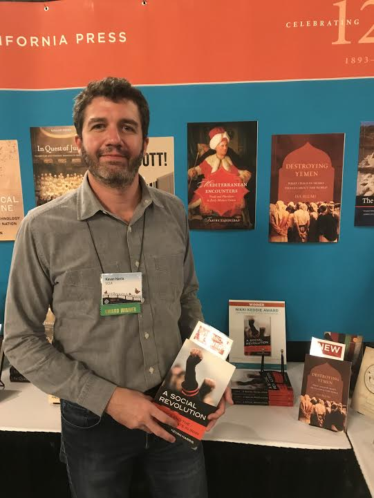 Kevan Harris with his book at the UC Press booth at the 2018 MESA meeting. (Photo: UC Press.)