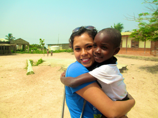 Ghana. Melina Melgoza (USA 2017) on an international service trip with Global Water Brigades in December 2013, holding her friend Dollitz. (Photo provided by subject).