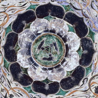 Apex of the ceiling of Cave 407 at Dunhuang, in China's Gansu province, c. 700, showing a trio of rabbits or hares inside a lotus motif.