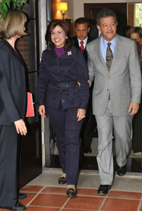Margarita Cedeño de Fernández, first lady of the Dominican Republic, and the president enter the patio at the Chancellor's residence. Elsie Walton, director of external affairs for the International Institute, is at left.