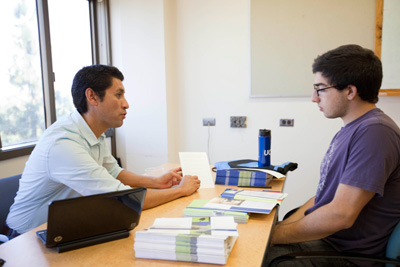 International programs counselor Danilo Bonilla advises a student interested in studying abroad. Bonilla is with UCLA's International Education Office.