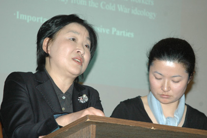 Jane Kim (right), a doctoral candidate in history in the UCLA Department of Asian Languages & Cultures, interpreted for Sim during the question period.