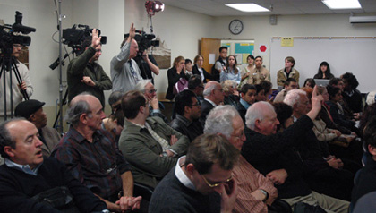 More than 100 people crowded into a conference room to hear the discussion. A follow-up talk will be set for Jan. 20.